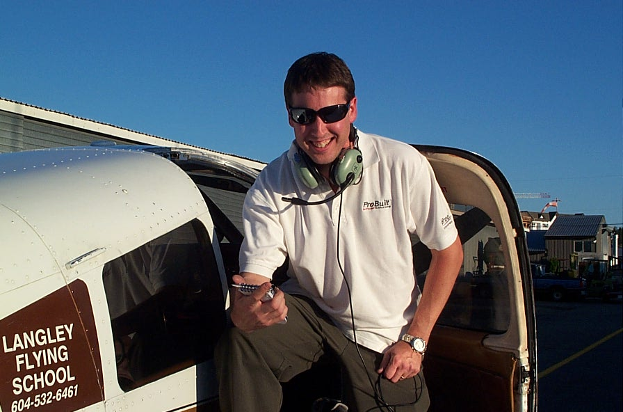 Dean Bicknell on the wing of Cherokee GUKG after completing his First Solo Flight on September 24, 2009.  Langley Flying School.
