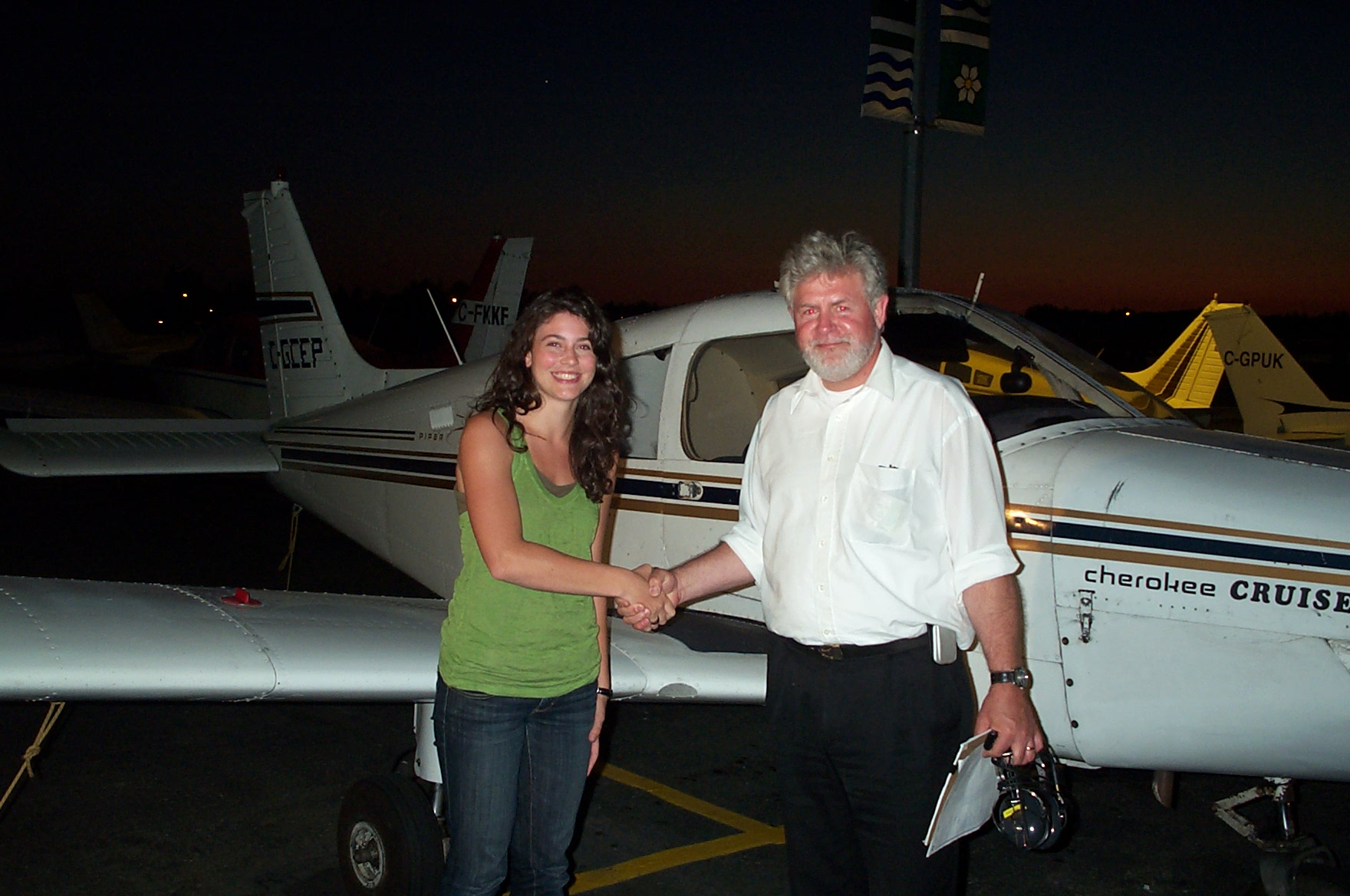Karlee Janzen receives contratulations from Pilot Examiner Paul Harris after the successful completion of Karlee's Private Pilot Flight Test on July 16, 2010. Congrats also to Karlee's Flight Instructor, Mayank Mittal. Langley Flying School.