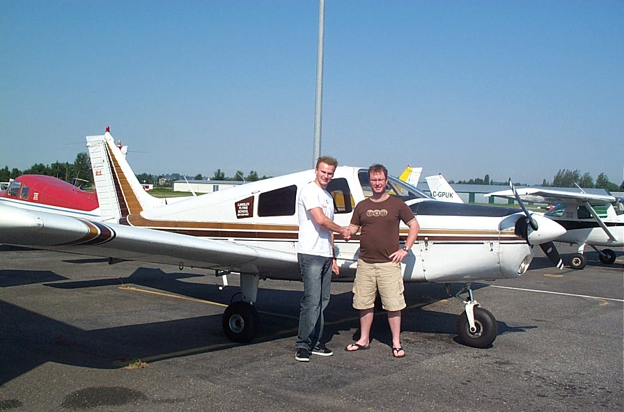 Lucas Turek receives congrats form Flight Instructor Darren Ferguson after the completion of Lucas' First Solo Flight on August 6, 2008.  Langley Flying School.