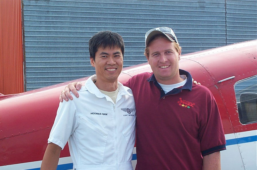 Matt Lusty with his Flight Instructor, Hoowan Nam, after the completion of Matt's First Solo Flight on August 22, 2008.  Langley Flying School.