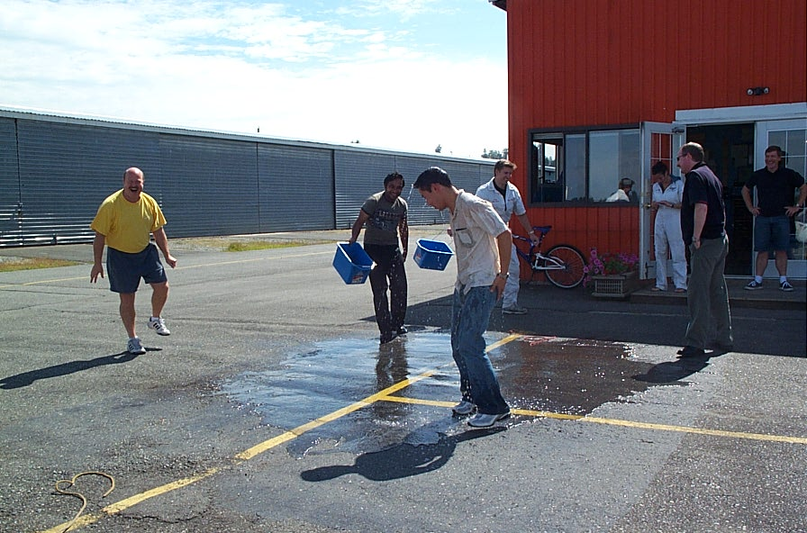 Nam Vu with his Flight Instructor, David Parry, and Transport Canada Inspector Peter Cox.  Phil Craig and Aniket Chavan do the bucket deed, with Flight Instructor Naomi Jones and Peter Waddington look on.  Langley Flying School.