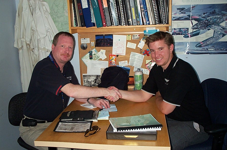 Philip Craig receives congratulations from Pilot Examiner Peter Cox after the successful completion of the qualiflying Flight Test for Phil's Class II Flight Instructor Rating.