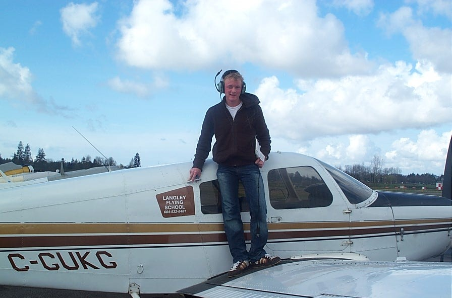 Ryan Kavanagh on the wing of Cherokee GUKG after the completion of his First Solo Flight.  Langley Flying School.