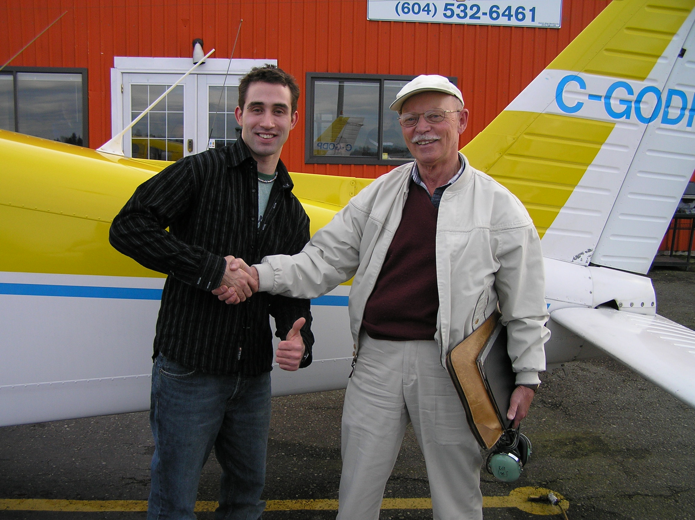 Shadrin Storness-Bliss with Pilot Examiner Donn Richardson after the successful completion of Shad's Private Pilot Flight Test. Langley Flying School.