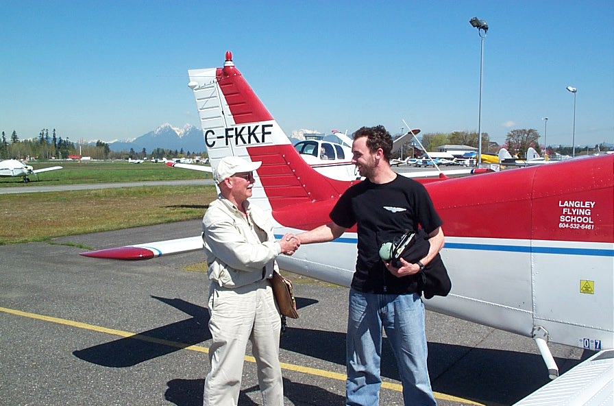 Steve Marsh with Pilot Examiner Donn Richardson after the completion of Steve's Private Pilot Flight Test.  Langley Flying School.
