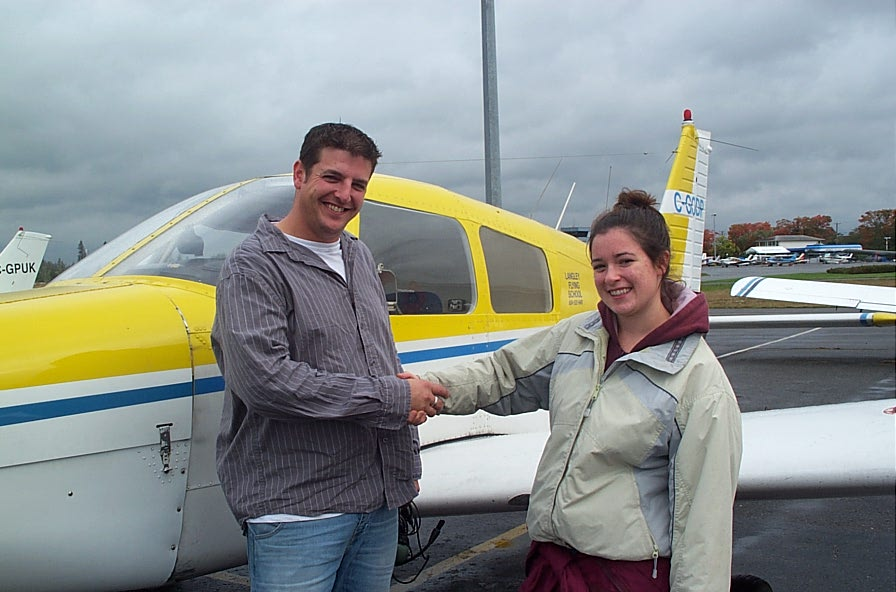 Tony McHale with Flight Instructor Naomi Jones, after completing his First Solo Flight on October 1, 2007.  Langley Flying School.