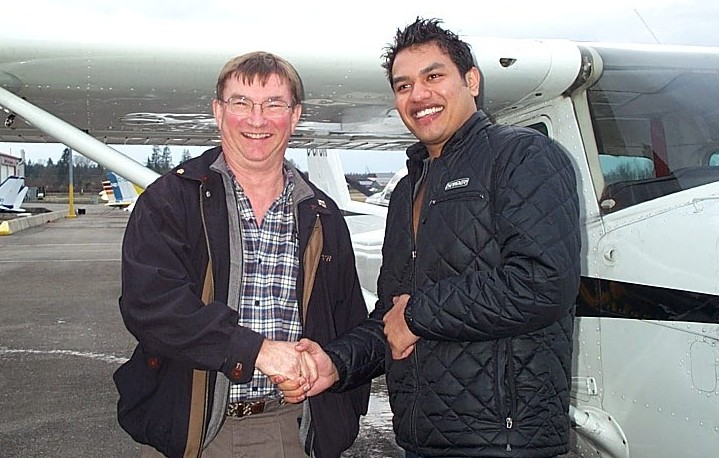 Vikas Chouidhary with Pilot Examiner John Laing after the successful completion of Vikas' Private Pilot Flight Test.  Langley Flying School.
